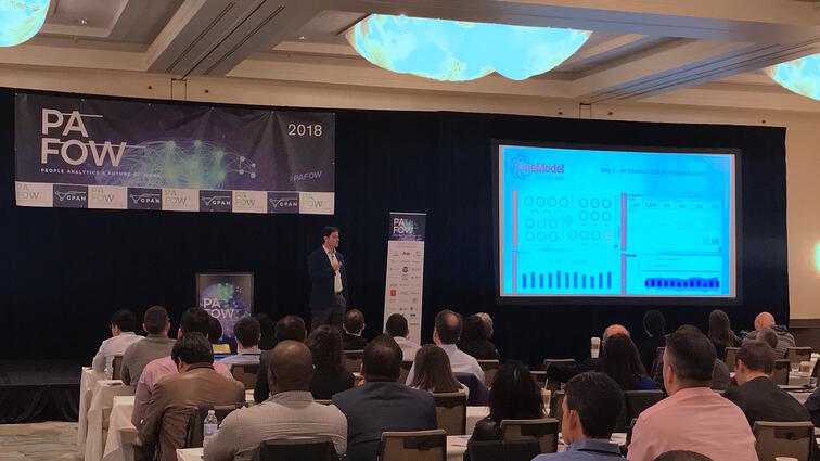 (Above) One Model CEO, Chris Butler, announces One Model's newest feature: One AI, at PAFOW in San Francisco.